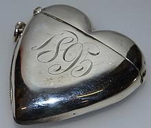A VICTORIAN HEART SHAPED VESTA.  Engraved with initials R.F.A. 1895.  Bi