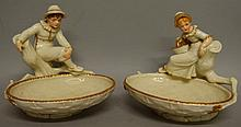 A ROYAL WORCESTER FINE PAIR OF KATE GREENAWAY FIGURAL COMPORTS depicted as a boy