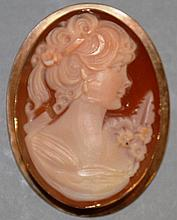 A GOOD OVAL CAMEO of a young lady, set in 9ct gold.