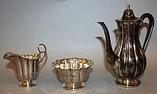 A CRIGHTON BROS STERLING SILVER THREE PIECE COFFEE SET, fluted form, comprising