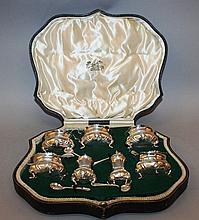 A SEVEN PIECE SILVER CRUET with six spoons, Birmingham 1908, Collingwood & Sons,