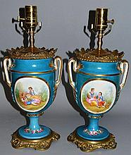 A PAIR OF SEVRES STYLE URN SHAPED LAMPS, blue grou