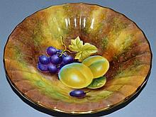 A ROYAL WORCESTER FACETTED DISH painted with fruit