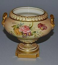 A ROYAL WORCESTER TWO HANDLED BLUSH IVORY PEDESTAL