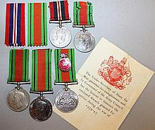 1939-1945 MEDAL with ribbon and FOUR DEFENCE MEDAL