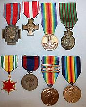 EIGHT MEDALS, various with ribbons.