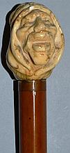 A CANE with carved ivory EGYPTIANS HEAD.    35ins