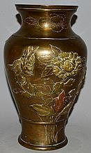 A CHINESE BRONZE VASE decorated with birds and chr