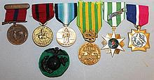 SIX VARIOUS MEDALS AND RIBBONS.