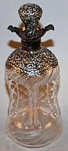 A VICTORIAN SILVER MOUNTED SPIRIT DECANTER AND STO