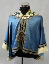A 19TH CENTURY CHINESE BLUE GROUND LADIES SILK JACKET, with cream ground em