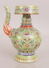 A GOOD QUALITY CHINESE TIBETAN MARKET LIME GREEN GROUND FAMILLE ROSE PORCEL