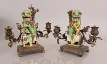 A PAIR OF BRONZE MOUNTED CHINESE FAMILLE VERTE PORCELAIN MODELS OF BUDDHIST