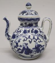 A CHINESE MING STYLE BLUE & WHITE PORCELAIN EWER & COVER, the base with a s