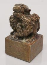 A CHINESE SQUARE SECTION BRONZE SEAL, the plinth surmounted by a buddhistic