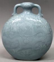 A GOOD QUALITY CHINESE CLAIRE-DE-LUNE PORCELAIN MOON FLASK, each side mould