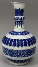 A CHINESE BLUE & WHITE MOULDED PORCELAIN EWER, decorated with multiple form