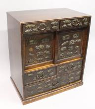 A LATE 19TH CENTURY JAPANESE MENUKI ONLAID WOOD CABINET, with sliding panel