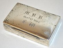 A SILVER PILL BOX dated 1905.