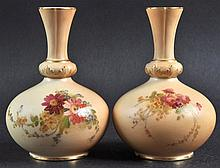 A PAIR OF ROYAL WORCESTER VASES painted with