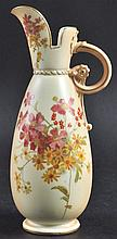 A ROYAL WORCESTER EWER painted with flowers, on a