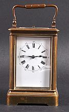 A 19TH CENTURY FRENCH BRASS CARRIAGE CLOCK with