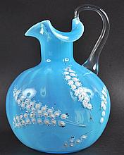 A BLUE GLASS VASELINE JUG painted with lilies of