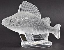 A LALIQUE FROSTED CARP on a circular base. 6.25ins