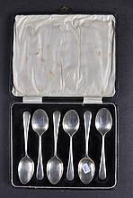 A SET OF SIX SILVER TEA SPOONS, in a fitted case.