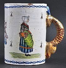 FRENCH ARMORIAL TIN GLAZE TANKARD. 5ins high.