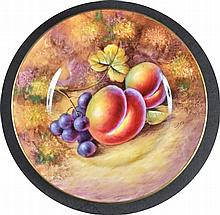 A ROYAL WORCESTER PLATE painted with fruit by J