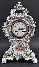 A 19TH CENTURY FRENCH PORCELAIN CLOCK, the