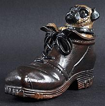 A COLD PAINTED GROUP, pug dog in a shoe. 5ins