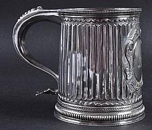 A QUEEN ANNE RIBBED TANKARD with oval cartouche