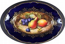 A ROYAL WORCESTER DISH painted by Sebright with