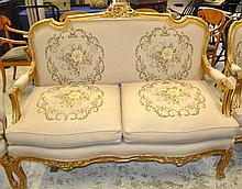 A LARGE LOUIS XVI DESIGN TWO SEATER GILT WOOD SOFA