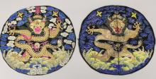 A NEAR PAIR OF EARLY 20TH CENTURY CHINESE EMBROIDERED SILK ROUNDELS