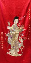 A GOOD QUALITY EARLY 20TH CENTURY LARGE CHINESE EMBROIDERED RED GROUND SILK WALL HANGING OF MAGU