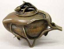 A 19TH CENTURY CHINESE BRONZE PEACH FORM CENSER