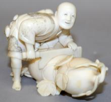 A GOOD QUALITY SIGNED JAPANESE MEIJI PERIOD IVORY OKIMONO OF A MAN SAWING A GIANT GOURD