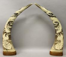 A LARGE PAIR OF 20TH CENTURY CHINESE HORN TUSK CARVINGS