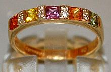 A GOOD SEVEN STONE MULTI-COLOURED RING set in 9ct