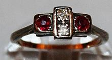 AN 18CT GOLD, RUBY AND DIAMOND RING.