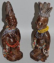 A GOOD PAIR OF CARVED WOOD YORUBA TWINS, male and