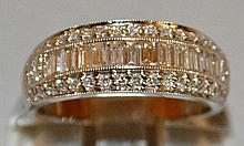 A GOOD TRIPLE ROW DIAMOND RING with a row of bague