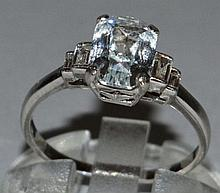 A GOOD WHITE SAPPHIRE AND DIAMOND RING set in plat