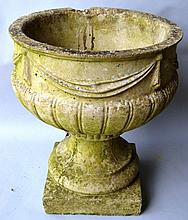 A RECONSTITUTED STONE PEDESTAL URN. 1ft 5ins high.