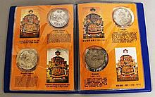 A CHINESE ALBUM OF COINS, consisting of 12 coins.