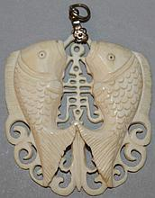 A CHINESE CARVED IVORY PENDANT of two fishes.