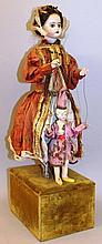 AN UNUSUAL FRENCH STANDING AUTOMATON PORCELAIN DOL